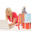 Young woman while online-shopping — Stock Photo
