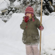 Little girl blows snow — Stock Photo #4585085