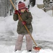Little girl blows snow — Stock Photo #4585126