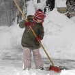 Little girl blows snow — Stock Photo #4585146