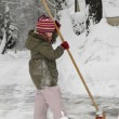 Little girl blows snow — Stock Photo #4585155