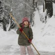 Little girl blows snow — Stock Photo #4585158
