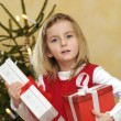 Girl with christmas gift — Stock Photo