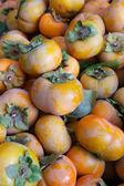 Pile of orange persimmons — Stock Photo