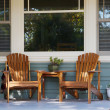 Stock Photo: Two adirondack chairs porch