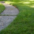 Curved path grass lawn low - Stock Photo