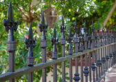 Black spike fence deeper dof — Stock Photo