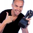 Handsome middle aged man with winners trophy — Stock Photo