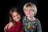 Young boy celebrates his 6th birthday with his sister — Stock Photo