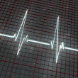 Light cardiogram on red grid — Stock Photo #5196530