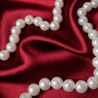 Stock Photo: Beads on red