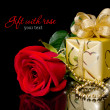 Gift with rose — Stock Photo