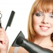 Woman with scissors, comb and hairdryer — Stock Photo