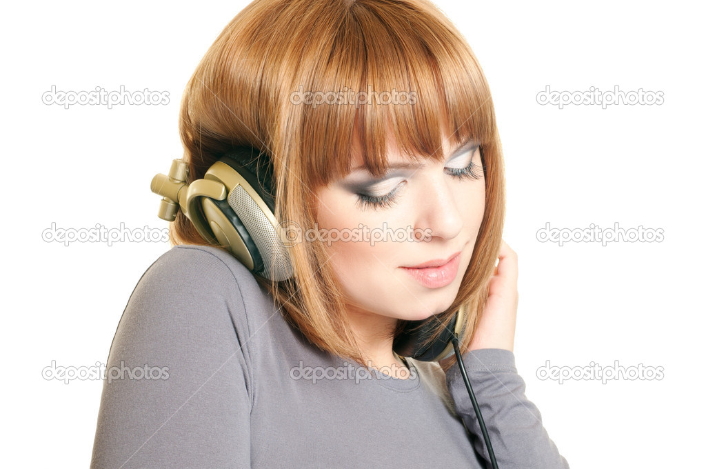 Beautiful red-haired girl with headphones isolated over a white background — Stock Photo #5032079
