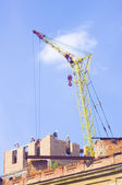Cranes and house construction — Stock Photo