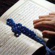 Worshiping holy koran — Stock Photo
