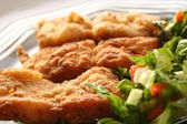 Fried fish fillet in dish with salad — Stock Photo