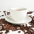 Coffee cup and coffee beans on white background - Stock Photo