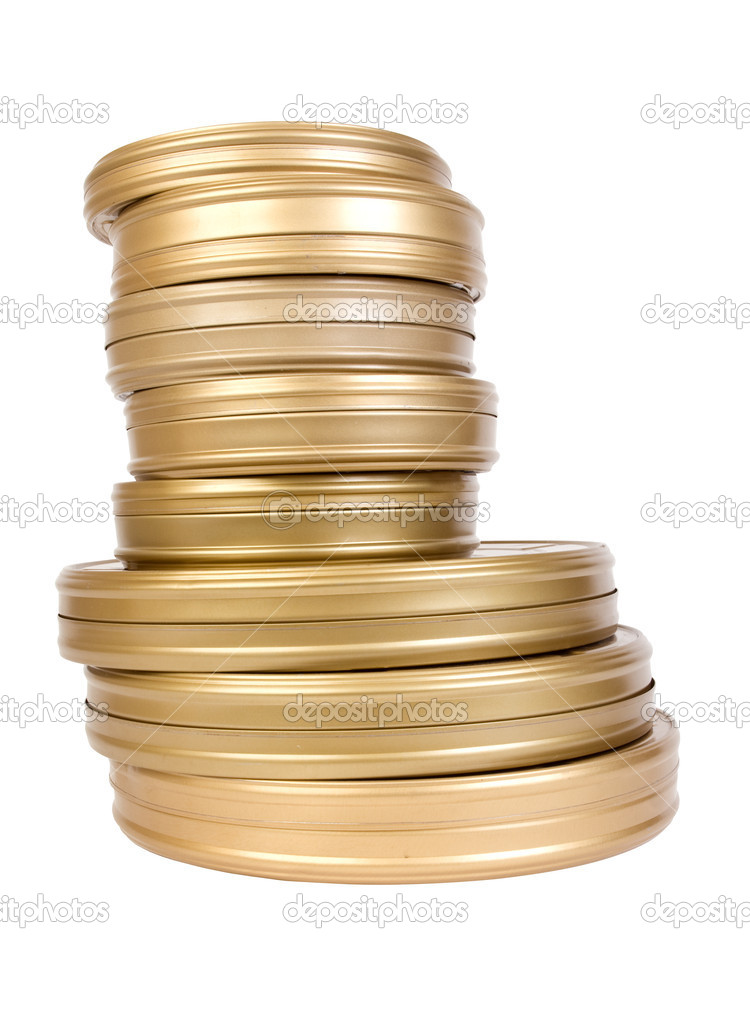 Pile of tins with a film on a white background — Stock Photo #4938119