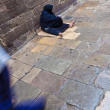 Beggar woman - Stock Photo