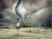 Boy and tornado — Stock Photo