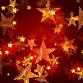 золотые звезды в красном — Стоковое фото
