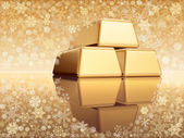 Christmas golden bullions with snowflakes — Stock Photo