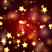 Golden stars in red and violet lights — Stock Photo