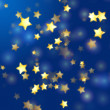 Stock Photo: Golden stars in blue