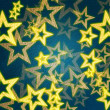 Stock Photo: Golden stars in blue background