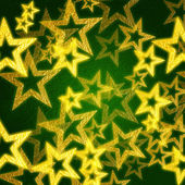 Golden stars in green background — Stock Photo