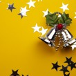 Stock Photo: Christmas Bells On The Yellow Background