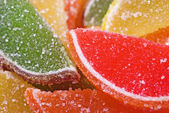 Citric segments in sugar, close-up — Stock Photo