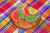 Citric segments in sugar — Stock Photo