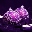 Violet Christmas Balls and Candles - Stock Photo