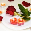 Romantic Inviting Table with Rose and Candles - Stockfoto