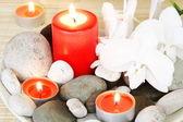 Wellness kameny, svíčky a orchideje — Stock fotografie