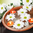 Aroma Bowl with Flowers and Candles — Stock Photo