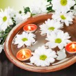 Aroma Bowl with Flowers and Candles - Stock Photo