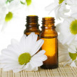 Essential Oil Bottles with White Daisy - Stock Photo