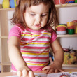 Little Girl Learning Figures and Letters - Stock Photo