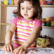 Stock Photo: Little Girl Learning Figures and Letters
