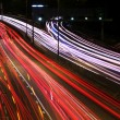 Night highway (Cars in a rush moving fast on a highway (speedway - Stock Photo