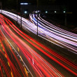 Stock Photo: Night highway (Cars in a rush moving fast on a highway (speedway