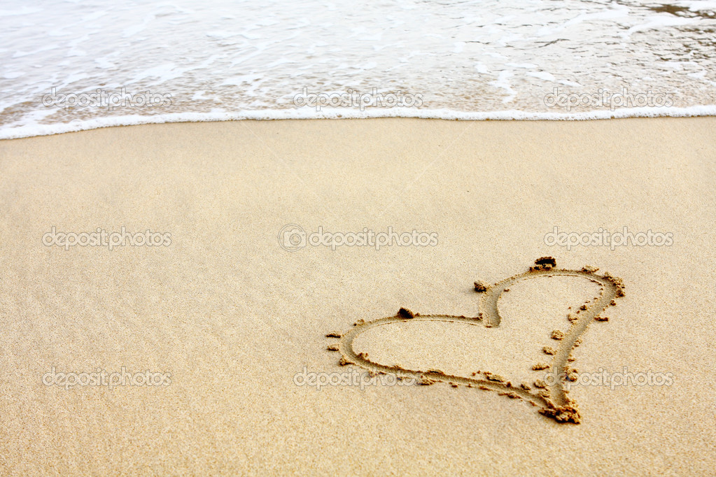 Hearts drawn in the sand with seafoam and wave — Stock Photo #4306711