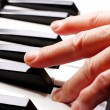 Royalty-Free Stock Photo: Piano and hand close up