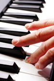 Piano and hand close up — Stock Photo