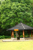 Small pavilion among nature with forest background — Stock Photo