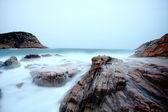 Pedras do mar ao pôr do sol — Fotografia Stock