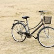 Bicycle on gass field - Stock Photo